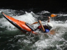 Kayaker trying to escape a whirlpool